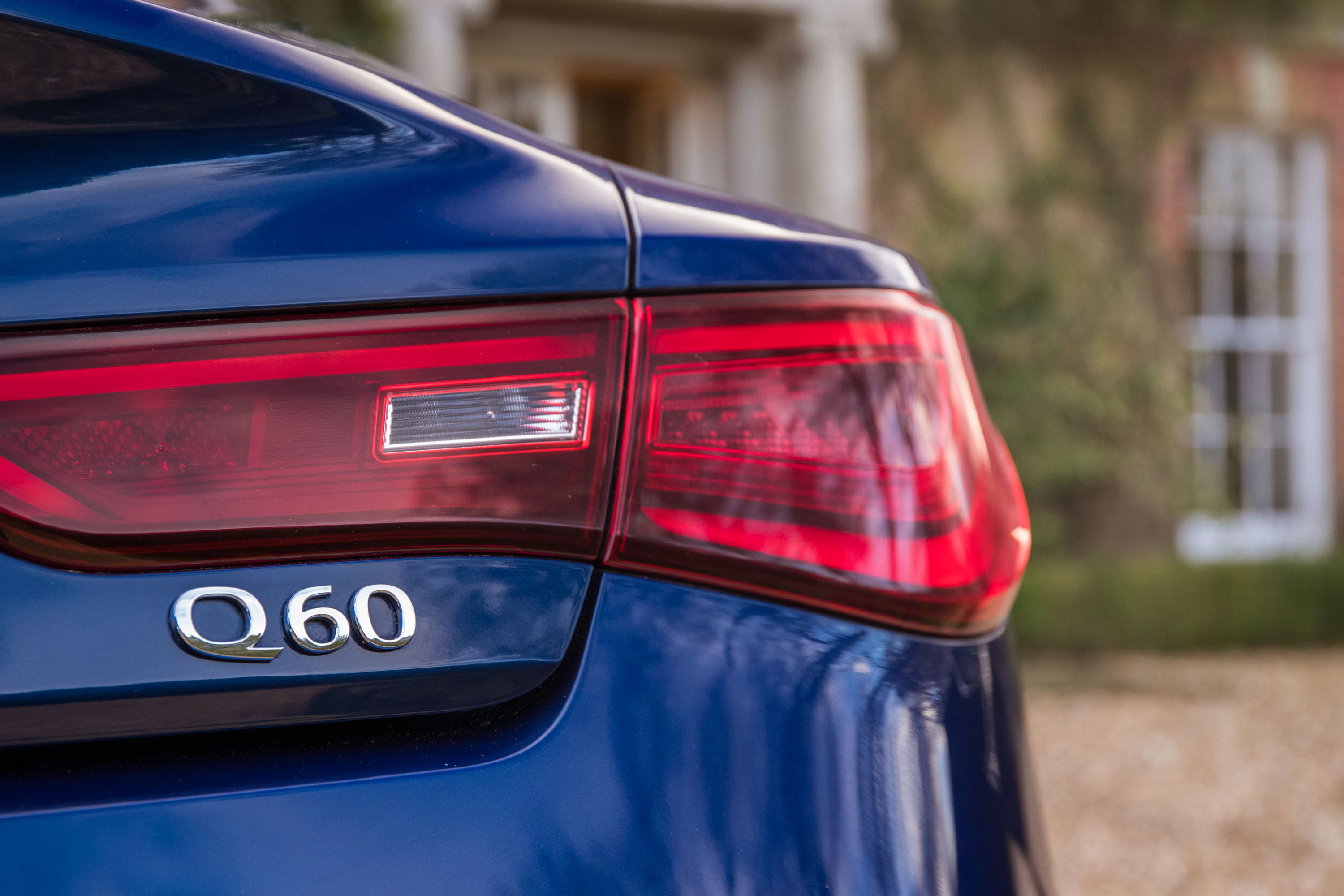 Flat-Out Infiniti Q60 badge