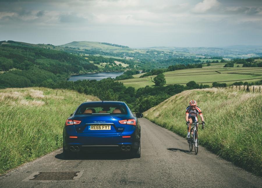 Maserati Ghibli and cyclist - Goyt Valley